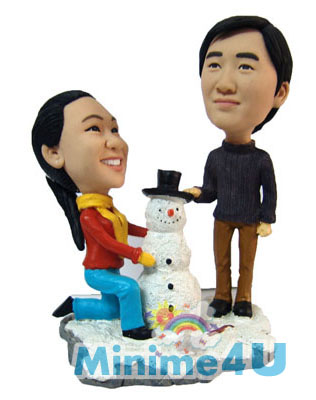 Couple are making snowman