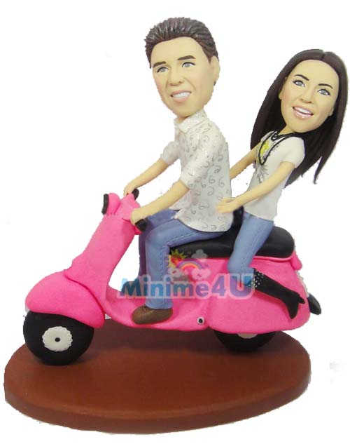 couple riding motor bike